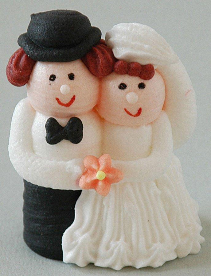 Brautpaar aus Zucker, mit lachsfarbener Blüte, ...